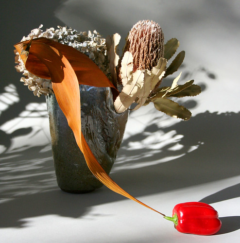 Ikebana with red pepper and dried materials