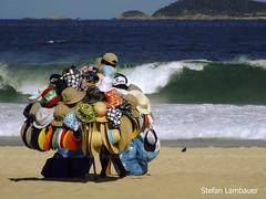 Ipanema  - Rio de Janeiro (Stefan Lambauer) Tags: sea brazil praia beach brasil riodejaneiro vendedor mar br rj hats wave 2009 ipanema chapéus bonés mywinners colorphotoaward stefanlambauer goldstaraward 100commentgroup