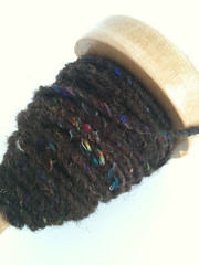 A spindle full of Shetland and Sari Silk