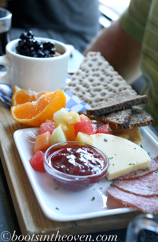 Swedish Breakfast Bord: brown bread and rye crisp, cured meat, smoked trout, hard cheese, seasonal citrus, yogurt with fruit and granola and daily salad ($12)
