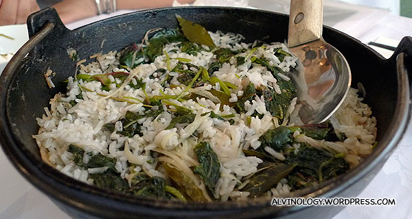 Rice served with organic greens in an earthen pot