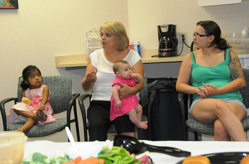 Beth Taylor, Peer Counseling Coordinator for Shenandoah Valley WIC and Nutrition Services, provides encouragement to new mothers at the community breastfeeding support group August 6 in Martinsburg, West Virginia.