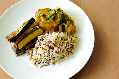 Pork curry, rice, roasted eggplant and courgette