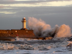 The rising sun catches the waves... (paul downing) Tags: lighthouse canon pier waves redcar southgare pd1001 sx10is pauldowning