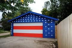 A True American!! (Cragin Spring) Tags: trees roof urban wisconsin america fence stars midwest stripes flag garage border patriotic driveway american americana redwhiteblue beloit starsstripes