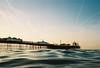brighton pier and sky trails (lomokev) Tags: sea sky pier nikon brighton kodak kodakportra400vc portra brightonpier palacepier nikonos skytrails kodakportra400 kodakportra deletetag nikonosv nikonos5 nikonosfive file:name=100924nikonosvvc01 roll:name=100924nikonosvvc