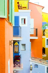 Colours of Saint Tropez (5ERG10) Tags: blue windows light portrait orange holiday france green lamp colors sergio lines june yellow wall architecture alpes happy 50mm hotel spring nikon cotedazur colours shadows natural chairs squares weekend couleurs balcony shapes happiness sttropez shutters balconies walls colourful provence cheerful nikkor f18 francia groupe var architettura luce vacanza sud 2010 byblos muri provenza albergo htel sainttropez allegria d300 persiane balconi upbeat pareti verande floriat amiti 5erg10 vacatio2010