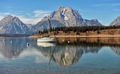 A Sailboat at Jackson Lake (Jeff Clow) Tags: vacation holiday reflection sailboat landscape escape getaway wyoming tetons pleasure grandtetonnationalpark jacksonlake buoyant mywinners gapr flickrdiamond