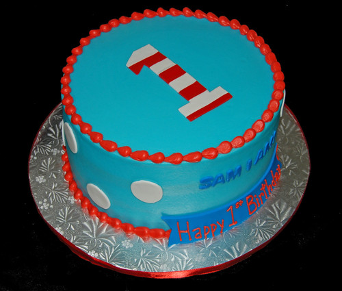 blue and red first birthday cake for a Dr Seuss themed celebration