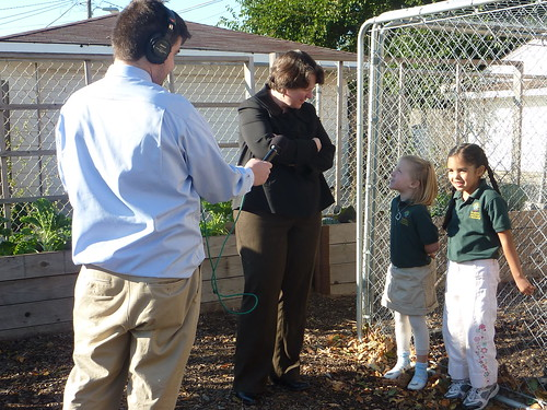 Deputy Secretary Merrigan listens as two students from the Academy of Global Citizenship explain what they feed their chickens and why.