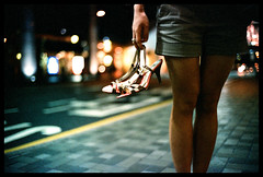 Picking up some new shoes? (Lefty Jor) Tags: street leica light hk film girl night hongkong 50mm shoes dof bokeh voigtlander heels agfa f11 m6 nokton misu vista400 voigtlandernokton50mmf11