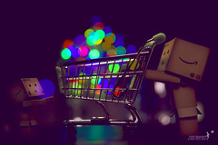 Whoever said money can't buy happiness..they simply didn't know where to go for their shopping  ^^ (achew *Bokehmon*) Tags: blue red money color green smile mall shopping toy robot amazon bokeh box quote trolley sony happiness alpha danbo a850 danboard