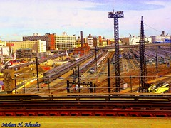 A View Of Long Island City and Sunnyside Railroad Yards and Buildings (nrhodesphotos(the_eye_of_the_moment)) Tags: nyc building metal lights view towers tracks trains wires rails railing sheds thirdrail roadways communicationtowers northernblvd longisandcity nrhodesphotosyahoocom wwwflickrcomphotostheeyeofthemoment theeyemomentphotosbynolanhrhodes dscn52434077 longislandrailroadyard