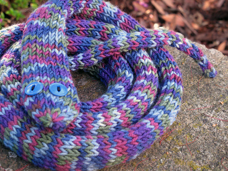 Used the wiggly worm scarf pattern from the knitting pretty book by