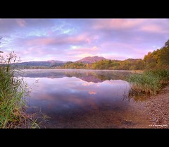 Loch Achray (Kit Downey) Tags: morning pink blue autumn trees sky brown lake color colour green water clouds sunrise canon reflections reeds landscape eos rebel scotland early october scottish tokina kit loch trossachs autumnal hdr gloaming stirlingshire downey achray 550d t2i 1116mm
