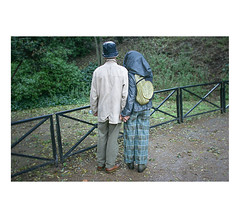.. (slow paths images) Tags: paris france europe jardindesplantes garden park people man women couple together handinhand tight rain rainyday wet green nature quiet peaceful fence