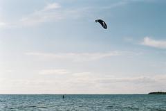 Kite surfing (michael.klokta) Tags: surfing плёнка пленка ягорлыцкий залив черноморский биосферный заповедник чёрное море херсон украина лето blacksea biosphere reserve ukraine kherson summer 35mm film nikon f80 nikkor 50mm f18 sea sky clouds outdoor seascape water kite kitesurfing bay