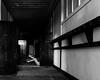 Her blacks crackle and drag (sadandbeautiful (Sarah)) Tags: me woman female self selfportrait abandoned hallway doors legs bw monochrome abandonedschool school churchschool ny