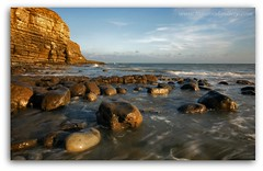 ROCKS AND PEBBLES (IMAGES OF WALES.... (TIMWOOD)) Tags: sunset sea beach water southwales clouds evening coast rocks colours sony pebbles cliffs alpha valeofglamorgan lowsun rockpools nashpoint a700 marcross thewelshsphinx