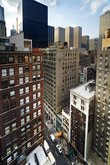 In the middle of nowhere.. in Midtown (Tony Shi Photos) Tags: york newyorkcity urban ny newyork skyscraper buildings metro manhattan midtown metropolis rockefeller ge hdr density dense nuevayork midtownmanhattan   highangleview xyzbuildings d700  nikond700   tonyshi