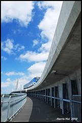 Canada Line N2646e (Harris Hui (in search of light)) Tags: bridge blue sky white canada lines vancouver clouds train subway nikon bc metro richmond walkway curve fraserriver rumbling d300 18200mm happylongweekend canadaline nikon18200mmvr overthebridge nikonuser wonderfulsky pedestrainwalkway nikond300 harrishui vancouverdslrshooter cloudscollector