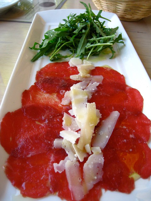 Carpaccio of 1824 Premium Beef with Truffle Salt, Parmesan Cheese & Rocket Salad