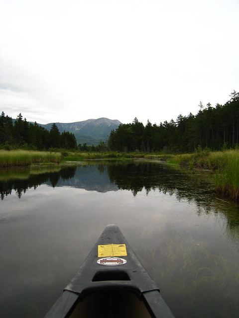 The nose of the canoe is pointing straight at Katahdin