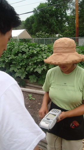 Windy City Harvest Staff processes an Illinois LINK card with the garden's new EBT Machine at the Midwest Region's People's Garden.