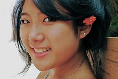 the girl with the flower in her hair (*alicja*) Tags: portrait flower girl beautiful smiling asian pretty posing sage ahir 50mmf18 nikond40x