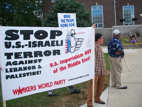 Members of MECAWI hold banner at the pro-Palestine rally held in honor of the Al-Quds Day at the Dearborn City Hall on September 3, 2010. (Photo: Abayomi Azikiwe) by Pan-African News Wire File Photos