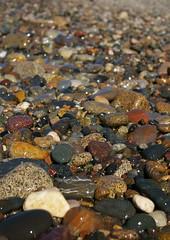 Pebbles (Sue Langford) Tags: wet sunshine wales seaside shoreline pebbles pentaxk100dsuper chooseyourfavourite