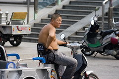 Buddha belly (ctownjb) Tags: china shirtless man bike asian asia head chinese shaved belly chinadigitaltimes ctrippic