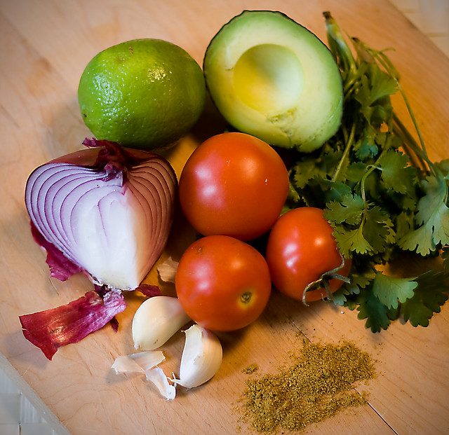 Lime, avocado, garlic, red onion, cilantro, tomatoes and curry powder