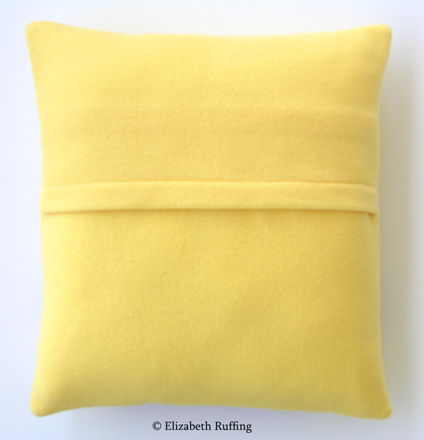 Yellow fleece decorative throw pillow back with envelope closure by Elizabeth Ruffing