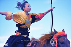 My favorite archer at the Yabusame contest.  Glenn E Waters. Japan. Over 10,000 visits to this image. (Glenn Waters in Japan.) Tags: sky horse beautiful japan lady clouds japanese nikon traditional martialarts  archery hirosaki archer matsuri japon horseback  yabusame    5photosaday   d700 nikond700  glennwaters  photosjapan  afsnikkor70200mmf28gedvrii
