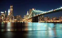 Brooklyn Bridge (Rafakoy) Tags: city longexposure bridge ny newyork color colour building film water colors skyline architecture brooklyn night 35mm buildings river dark lights nikon cityscape colours kodak manhattan 28mm bridges slide f100 nikonf100 late positive nikkor ektachrome e6 e100vs nite kodakektachromee100vs afnikkor2880mmf3356g nikkonaf2880mmf3356g aldorafaelaltamirano rafaelaltamirano aldoraltamirano