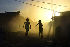 Ulingan (Charcoal factory), Tondo - Running into the wall of smoke (Mio Cade) Tags: poverty boy sunset toxic children evening kid factory afternoon smoke run burn charcoal pollution manila carbon choke monoxide tondo ulingan