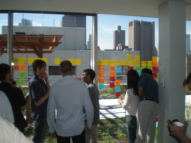 Many post-it notes on a wall - a sticky note brainstorm