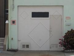 Step one: Cut a hole in the door (jbuike) Tags: foundinsf garagedoor inlawapartment gwsf