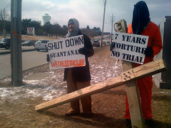 Winter 2008/2009 Anti-Torture Vigil in West Des Moines, IA (Shrieking Tree) Tags: usa signs sign america army cross cia military protest photojournalism iowa christian demonstration torture humanrights vigil protesters guantanamo abughraib abuse jumpsuit kandahar johnyoo photojournalist gitmo degrading inhumane detainees bagram boilersuits d80 protectthehuman waterboarding