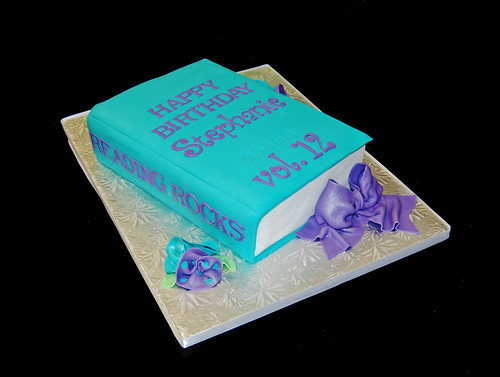 turquoise and purple 3D book cake for a 12th birthday