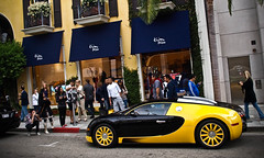 Crowdstopper. (Noah Gillard Photography) Tags: motion black cars car yellow speed french drive cool italian power fast olympus hills rodeo beverly bugatti coupe supercar fastest sportscar horsepower veyron bijan hypercar e520 noahgillardphotography
