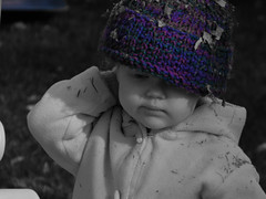 Purple Haze. (Taylor Q. MacLeod) Tags: old autumn blackandwhite bw baby fall girl leaves youth outside one leaf sweater purple year deadleaves young toque woollyhat averie