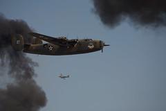 Ol 927 in Smoke (Bill Jacomet) Tags: raw airshow b24 iphotooriginal toratoratora wingsoverhouston ellingtonfield ol927