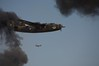 Ol 927 in Smoke (Bill Jacomet) Tags: raw airshow b24 iphotooriginal toratoratora wingsoverhouston ellingtonfield ol927