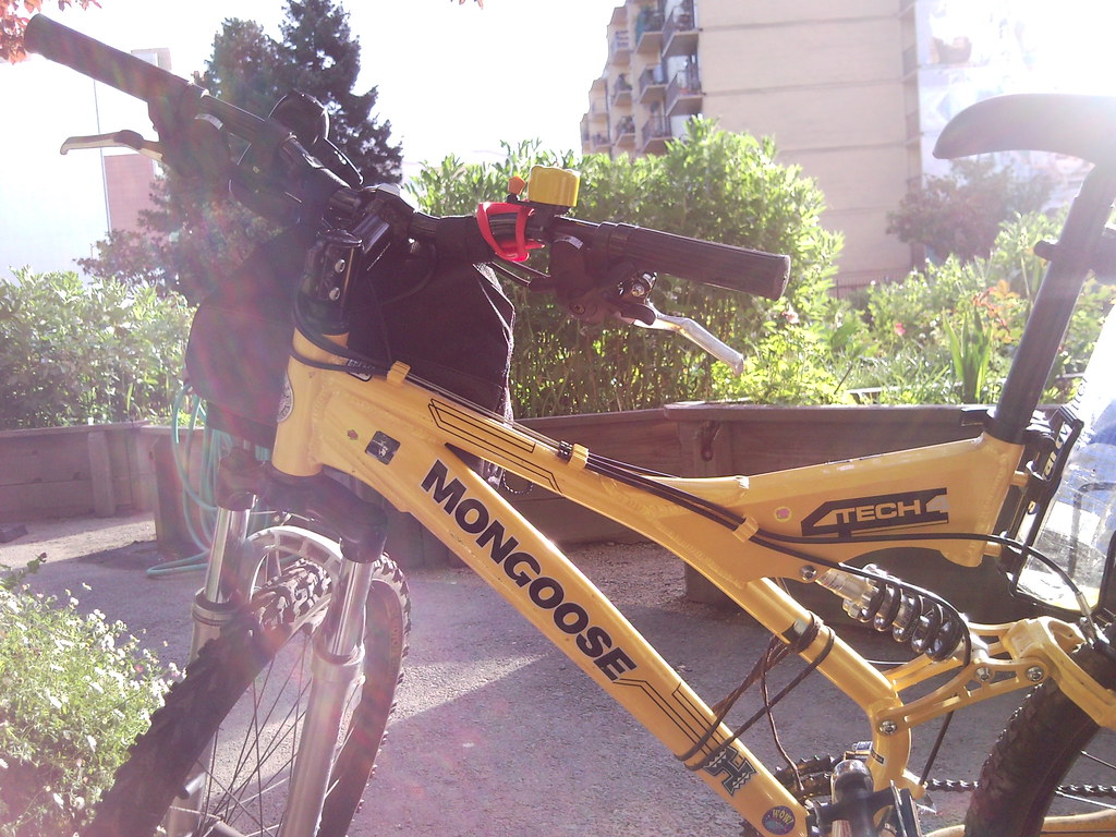Mongoose Yellow Hybrid Bike at a community gargen