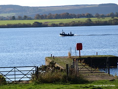 Ferryboat 2 (B4bees) Tags: blue green water sunshine scotland lifebelt gates tourists passengers photographs shore visitors ferryman historicscotland daysout ferryboat treest lochleven olympuse510 lochlake gununenlyisithebestofday brianforbes kirkgatepier