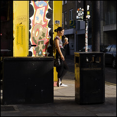 Brick Lane bin (jonron239) Tags: london coffee girl sunshine yellow cigarette bin shoreditch trendy brunette streetcorner bricklane blackbag blacktights whitemules zebratop pinghim