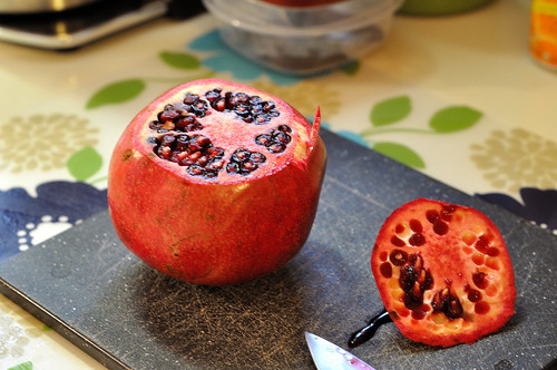 Step 1, slice the head off of the pomegranate