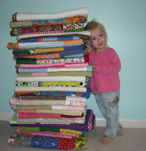 my girl with the KCMQG charity quilts